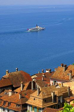 IBLGVA01398317 Excursion boat on Lake Geneva passing the medieval village of Saint-Saphorin, Lavaux UNESCO World Heritage region on Lake Geneva, Vaud, Switzerland
