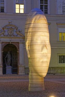 IBLMAN03100644 Marble sculpture 'Awilda' by the Catalan artist Jaume Plensa, Dietrichsruh-Platz square of the University of Salzburg, at dusk, Sigmund-Haffner-Gasse, Altstadt, Salzburg, Salzburg State, Austria