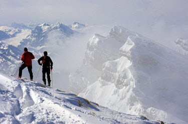 IBLSEI01508783 Climbers in front of wintry mountains, Wildhaus, Appenzell district, Canton of St. Gallen, Switzerland