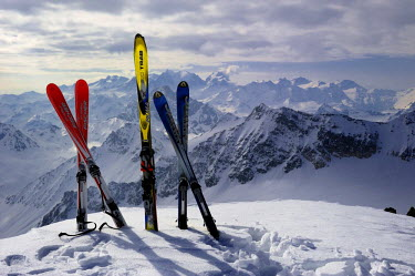IBLSEI01553278 Touring skis on a summit with mountain scenery, Julier Pass, Grisons, Switzerland