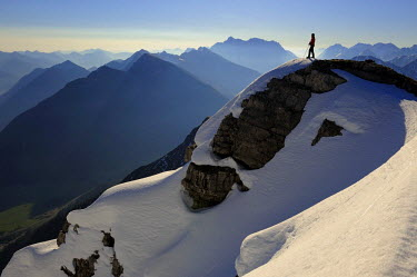 IBLSEI01925371 Wintery summit with climber in the early morning, Rutte, Ausserfern, Tyrol, Austria