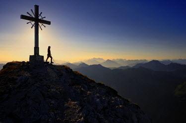 IBLSEI02357584 Summit cross with backlighting, Geisshorn Mountain, Tannheim Valley, Tyrol, Austria