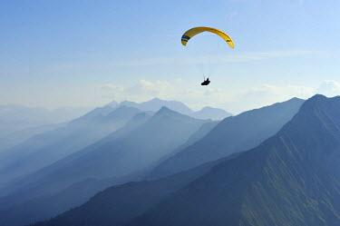 IBLSHU00933197 Paraglider in the Bernese Oberland, Niesen, Switzerland
