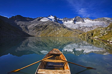 IBLVCH01078646 Boat in the lower Gerlossee lake, in front of Reichenspitze peak, Zillertal Alps, North Tyrol, Austria