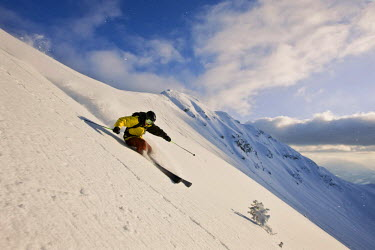 IBLVCH01124904 Freestyle skier in terrain covered in deep snow, Northern Tyrol, Austria