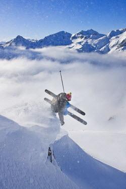 IBLVCH02020098 Freerider, skier jumping, snowy landscape, Engadin valley, Switzerland