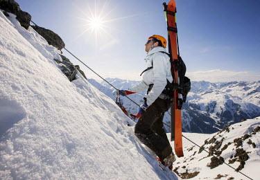 IBLVCH03799545 Mountain climber on the Winterklettersteig climbing route, Arlberg, Verwall Group, North Tyrol, Austria