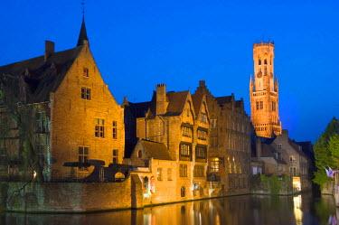 IBLGAB01911479 Illuminated Belfry and buildings along Rozenhoedkaai at dusk, historic centre of Bruges, Unesco World Heritage Site, Belgium