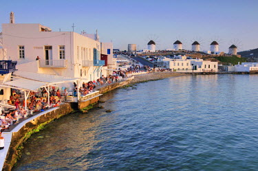 IBLGZS00897908 Tourists seated at restaurants in Little Venice, windmills, Mykonos Island, Cyclades, Greece