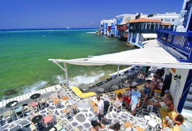 IBLGZS00897921 Bar located on the promenade along the port of Little Venice, tessellated stone floor, Mykonos Island, Cyclades, Greece