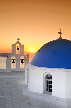 IBLGZS00903370 White Greek church with a blue dome and a bell tower at sunset, Firostefani, Santorini, Cyclades, Greece