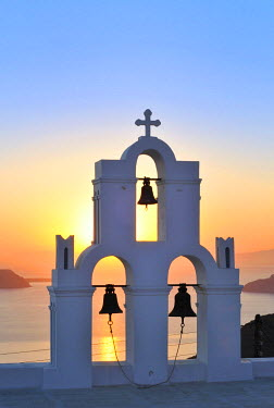 IBLGZS00903377 White Greek church with a blue dome and a bell tower at sunset, Firostefani, Santorini, Cyclades, Greece