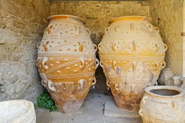IBLHAN00598692 Large clay vessels for storing food or oil in the Palace of Knossos, Crete, Greece