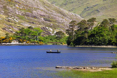 IBLMAN01646753 Angler sitting in a boat drifting on a lake, Delphi, Doolough valley, County Mayo, Connacht province, Republic of Ireland