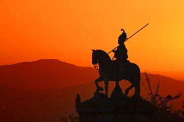 IBLGAB02124216 Sao Longuinhos equestrian statue at sunset, Bom Jesus do Monte Sanctuary, Braga, Minho, Portugal