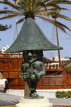 IBLMAN01140588 Bronze dwarf figure in front of Santa Maria, Plaza Alameda, Santa Cruz de la Palma, La Palma, Canary Islands, Spain