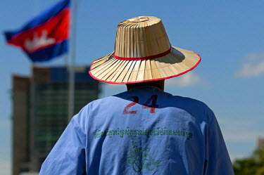 IBLGVA02441812 Rickshaw driver wearing a straw hat, Phnom Penh, Cambodia, Southeast Asia