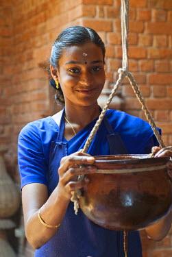 IBLOMK01939213 Woman applying Ayurvedic treatment, Somatheeram Ayurvedic Health Resort, Chowara, Malabar Coast, South India, India