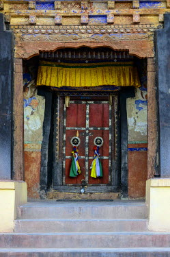 IBLFBD03716101 The old wooden entrance door of Matho Gompa, Ladakh, Jammu and Kashmir, India
