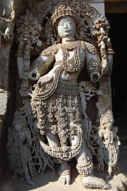 IBLMAN01485718 Gods reliefs on the outer wall of the Hoysaleswara Temple, Hoysala style, Halebidu, Karnataka, South India, India, South Asia