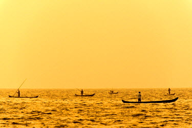 IBLOMK03618887 Fishermen in their boats at sunrise, Vembanad lake, Kerala, India