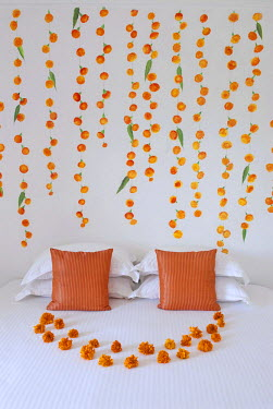 IBLOMK01869834 Wall painting and flower arrangements in a suite, Devigarh Palace Hotel, near Udaipur, Rajasthan, India