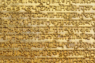 Gilt text from the Granth Sahib, the holy book of Sikhs, Harmandir Sahib or Golden Temple, Amritsar, Punjab, North India, India