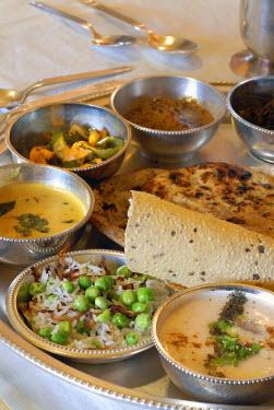 IBLOMK02069033 Rajasthani thali served on a silver tray, Narain, Niwas Heritage Hotel, Jaipur, Rajasthan, North India, India