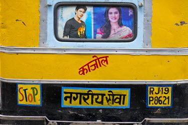 IBLOMK03603010 Rear of a motorised rickshaw with images of the Bollywood stars Sharukh Khan and Khajol, Jodhpur, Rajasthan, India