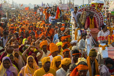 IBLFBD03152298 Procession of devotees dressed in orange, during Kumbha Mela, Allahabad, Uttar Pradesh, India