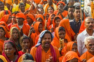 IBLFBD03152303 Procession of devotees dressed in orange, during Kumbha Mela, Allahabad, Uttar Pradesh, India
