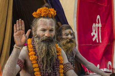 IBLFBD03152318 Shiva sadhu, holy man, at the Sangam, the confluence of the rivers Ganges, Yamuna and Saraswati, during Kumbha Mela festival, Allahabad, Uttar Pradesh, India