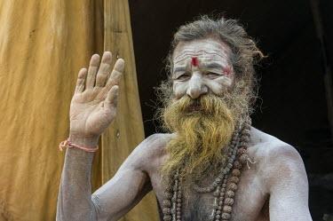 IBLFBD03152322 Shiva sadhu, holy man, at the Sangam, the confluence of the rivers Ganges, Yamuna and Saraswati, during Kumbha Mela festival, Allahabad, Uttar Pradesh, India