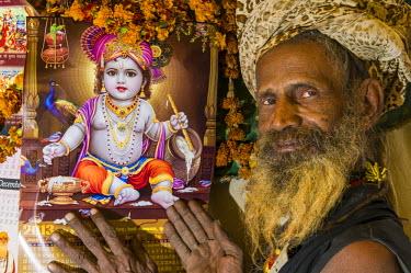 IBLFBD03152363 Udaisin Sadhu, holy man, at the Sangam, the confluence of the rivers Ganges, Yamuna and Saraswati, during Kumbha Mela festival, Allahabad, Uttar Pradesh, India