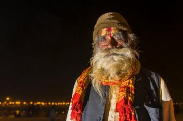 IBLFBD03152480 Rama sadhu, holy man, at night at the Sangam, the confluence of the rivers Ganges, Yamuna and Saraswati, during Kumbha Mela festival, Allahabad, Uttar Pradesh, India