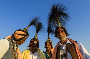 IBLFBD03152544 Group of Jangam Sadhus, holy men, at the Sangam, the confluence of the rivers Ganges, Yamuna and Saraswati, during Kumbha Mela festival, Allahabad, Uttar Pradesh, India