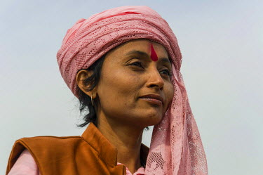 IBLFBD03152623 Portrait of a Sadhvi, holy woman, at the Sangam, the confluence of the rivers Ganges, Yamuna and Saraswati, during Kumbha Mela festival, Allahabad, Uttar Pradesh, India