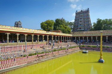 Temple pond, Gopuram or Gopura temple gate, temple district, Meenakshi Amman Temple or Sri Meenakshi Sundareswarar Temple, Madurai, Tamil Nadu, India