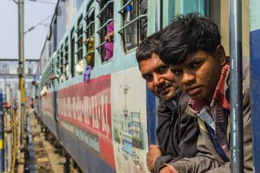 IBLFBD03152920 A train full of pilgrims at the railway station, Allahabad, Uttar Pradesh, India