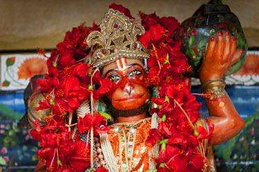 IBLOMK02294923 Hanuman, Hindu monkey god, red hibiscus flowers, Calcutta or Kolkata, West Bengal, East India, India