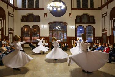 IBLMAN03000564 Whirling Dervishes dancing the Sema, a Dervish dance, Sirkeci Railway Station, Istanbul, Turkey, Istanbul, Istanbul Province, Turkey
