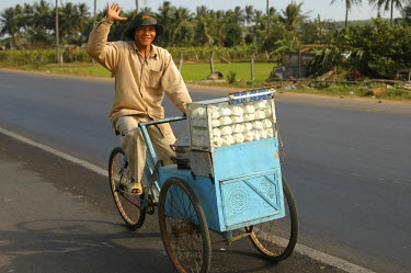 Dumplings vendor on a bike Vietnam