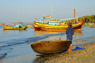 IBLGVA00946505 Fishing boats and a round boat on the beach of Mui Ne, Vietnam, Southeast Asia