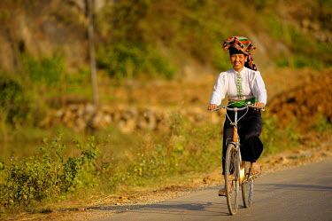 Vietnamese woman on bicycle, DinhBin, Hanoi, North Vietnam, Southeast Asia