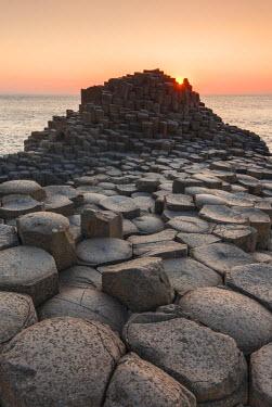 UK502RF UK, Northern Ireland, County Antrim, Bushmills, Giants Causeway, Unesco World Heritage Site, coastal rock formation of basalt, dusk