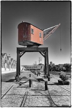 IBLGAB01985747 Gualeguaychu, crane on a pathway along historic warehouses, Entre Rios province, Argentina