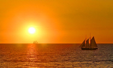 IBLGZS00762061 Sailing ships on the ocean at sunset, Broome, Western Australia, Australia, Oceania