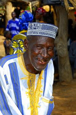 IBLGUF00585431 Smiling man with a cap, Burkina Faso, Africa