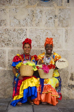 IBLTDR03809549 Two women wearing colourful dresses, Havana, Cuba
