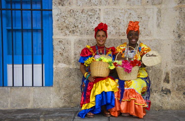 IBLTDR03809550 Two women wearing colourful dresses, Havana, Cuba